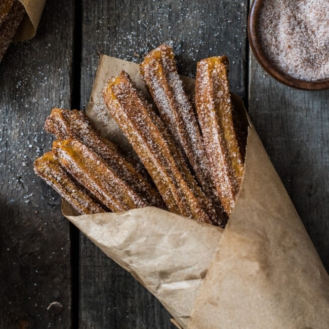 Baked Pumpkin Churros covered in cinnamon sugar are the perfect fall and winter dessert. They're baked, not fried, which means you can eat more of them!