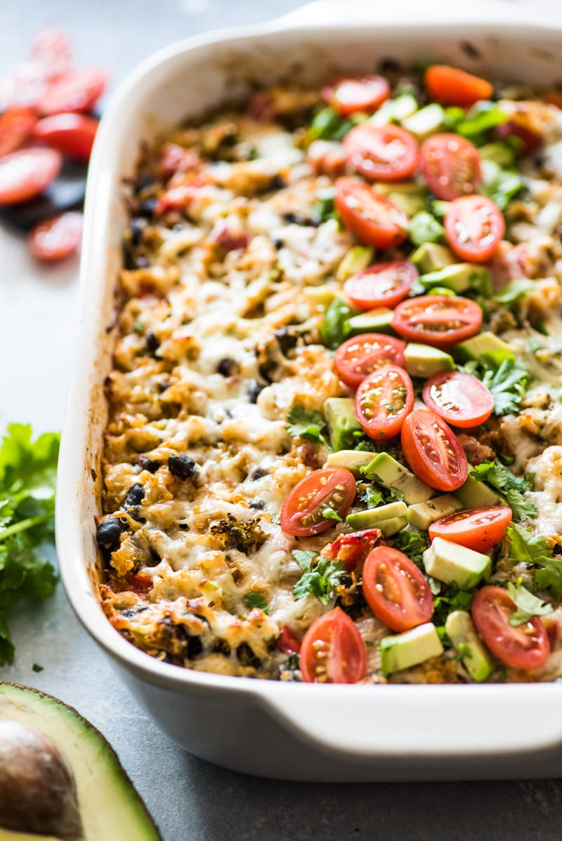 A Quinoa enchilada casserole in a baking dish ready to be eaten.