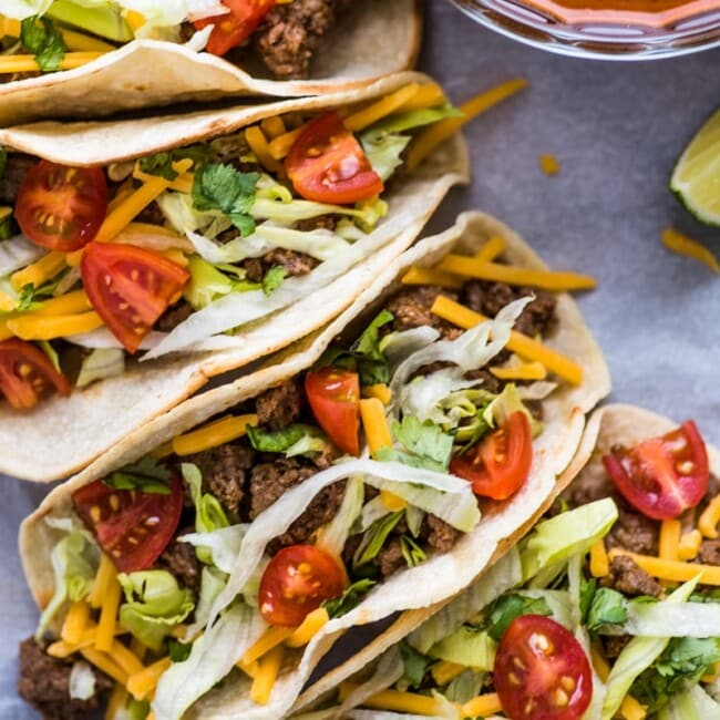 This Easy Ground Beef Tacos recipe made with a homemade taco seasoning packs a ton of flavor for a delicious weeknight meal ready in under 30 minutes!