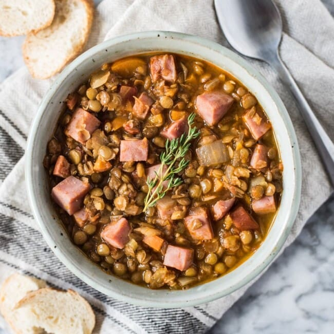 This Spicy Lentil Soup makes for a simple and hearty dinner. Full of healthy ingredients, it's an easy recipe that will keep you full and warm all season long (freezer friendly, gluten free) #mealprep #lentils #leftoverham #lentilsoup #spicysoup