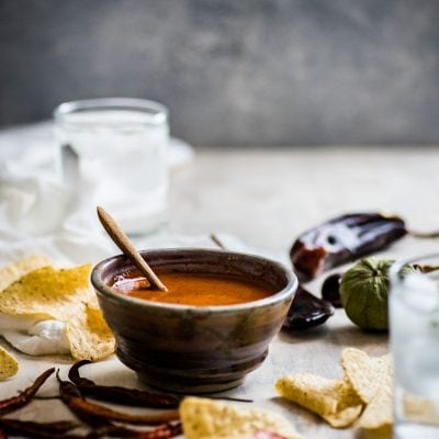 This Toasted Red Chile Salsa made with dried Arbol and New Mexico chiles, tomatillos and garlic is easy to make and perfectly spicy. Add to eggs, tacos and more!