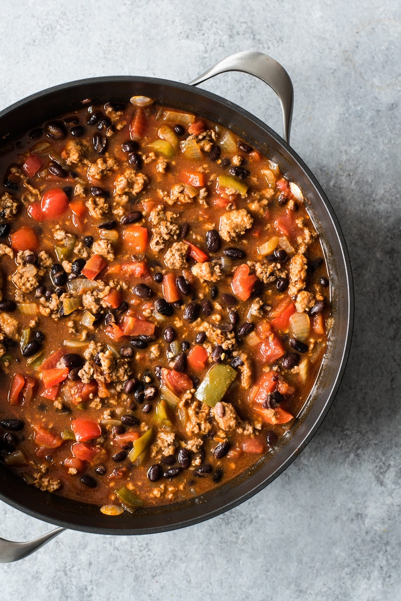 A pot filled with chorizo chili made with black beans.