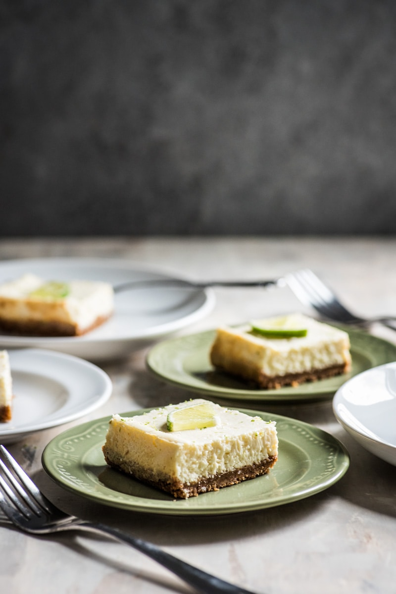 These Margarita Cheesecake Bars are creamy, made with a touch of tequila and sit on a buttery graham cracker crust.