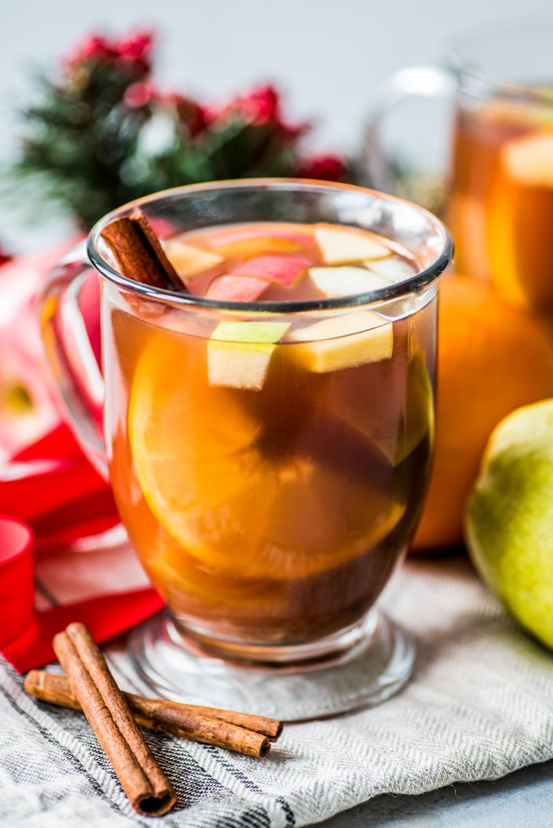 Mexican Ponche is a warm and comforting fruit punch made with apples, pears, oranges and guavas and spiced with cinnamon, cloves, tamarind and hibiscus typically served at Christmas time.