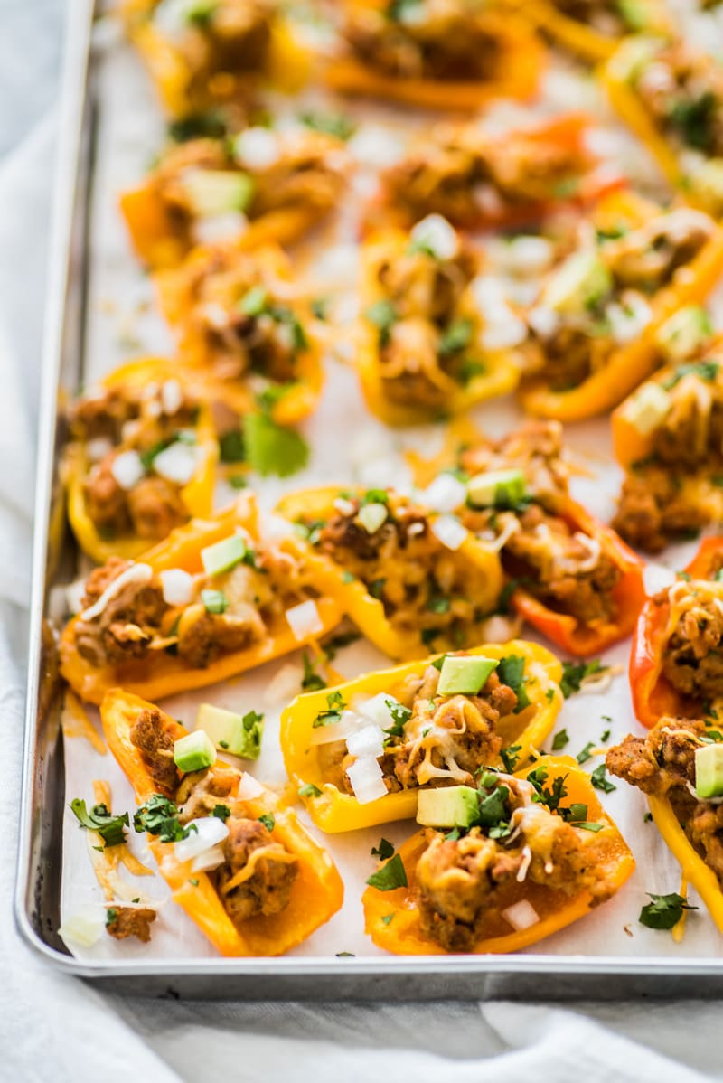 This Healthy Chicken Nachos recipe is made with mini bell peppers instead of tortilla chips! It's Low carb, gluten free and grain free!