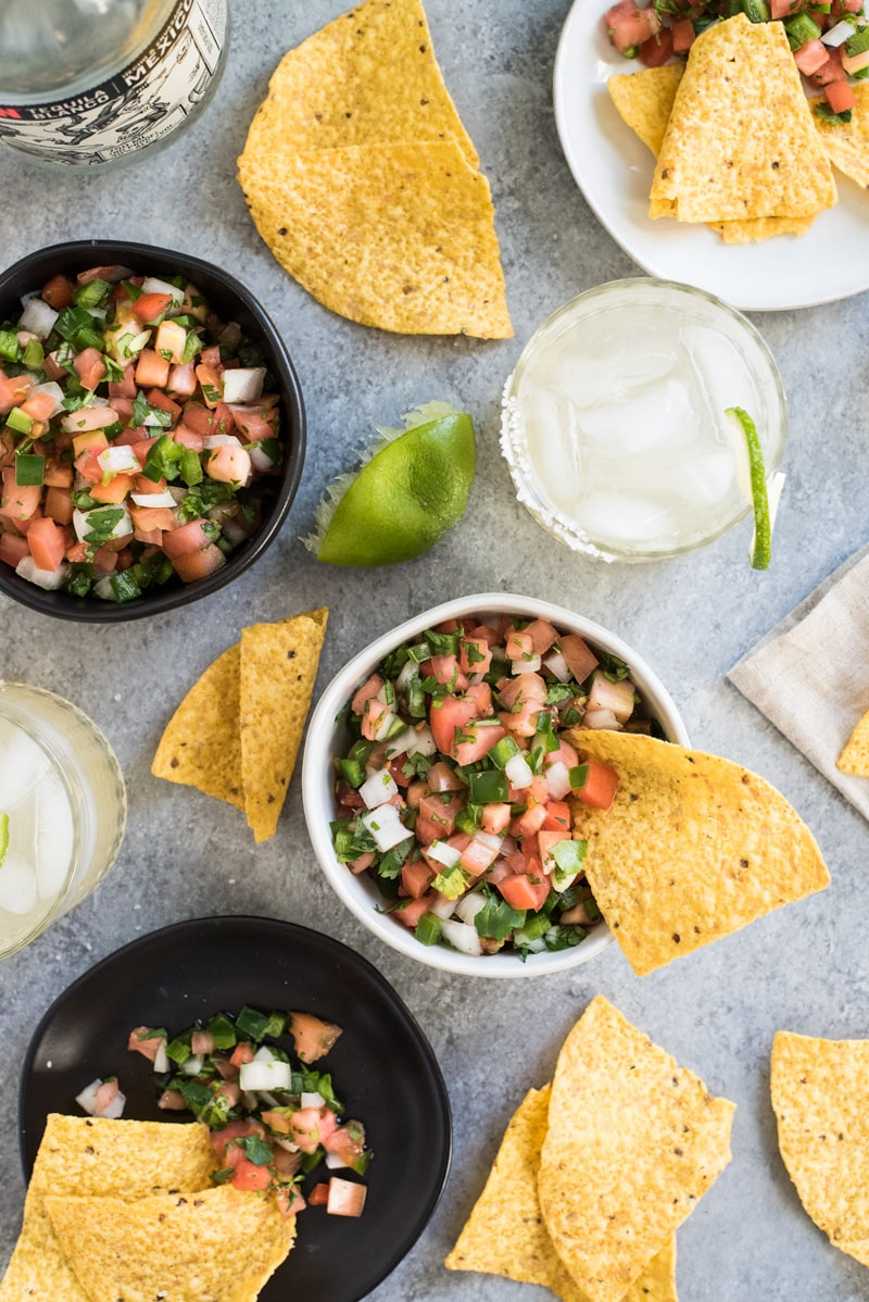 This Mexican Pico de Gallo recipe is made with fresh tomatoes, onions, jalapenos, cilantro and salt for a naturally gluten free, low carb, paleo, vegetarian and vegan salsa and appetizer!