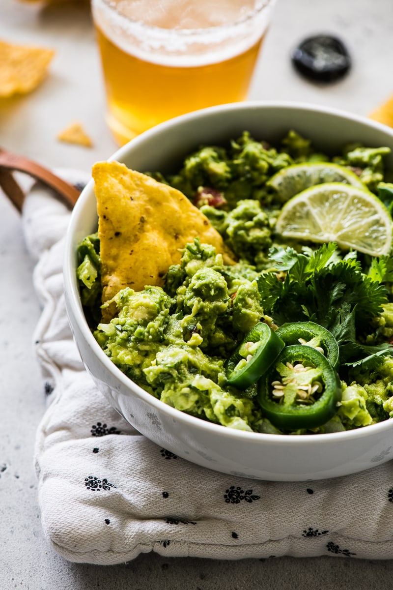 This simple and easy guacamole recipe is THE BEST! Ready in only 10 minutes, serve with chips, on a salad, in tacos and on toast! It's gluten free, dairy free, vegetarian, paleo and vegan.