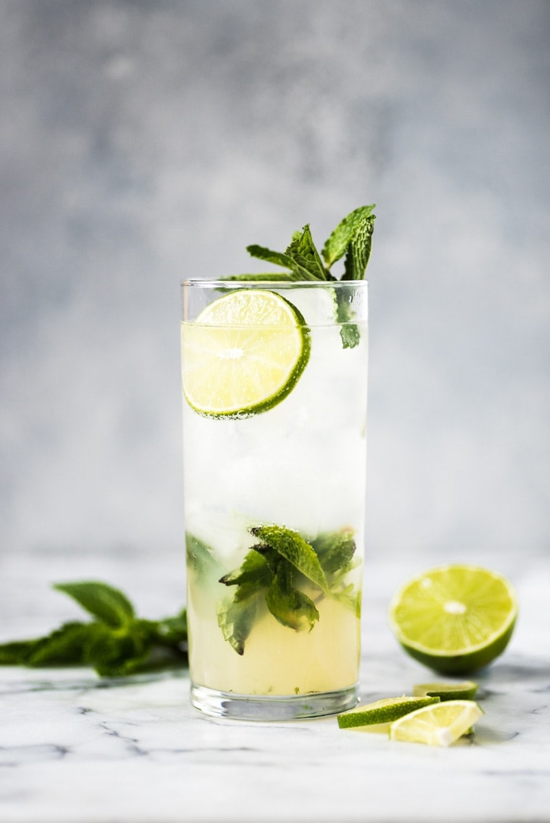 A classic mojito cocktail in a tall glass filled with ice.