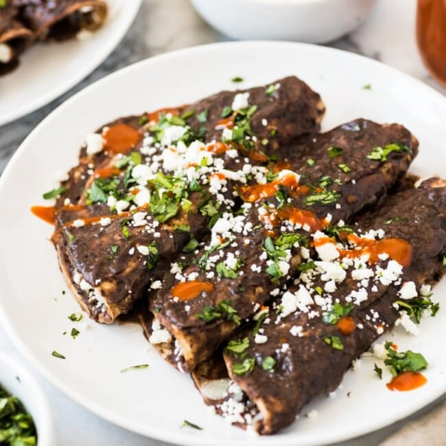 Enfrijoladas - Mexican enchiladas covered in a black bean sauce stuffed with cheese and ready in only 15 minutes! (vegetarian, gluten free)