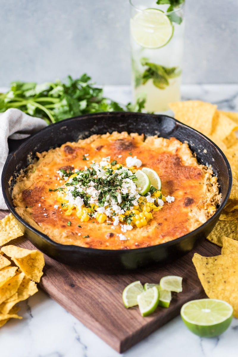 This Mexican Corn Dip recipe made whole kernel corn, lots of cheese and a blend Mexican spices is creamy, satisfying and addicting. It's the perfect appetizer for parties and celebrations like Cinco de Mayo!
