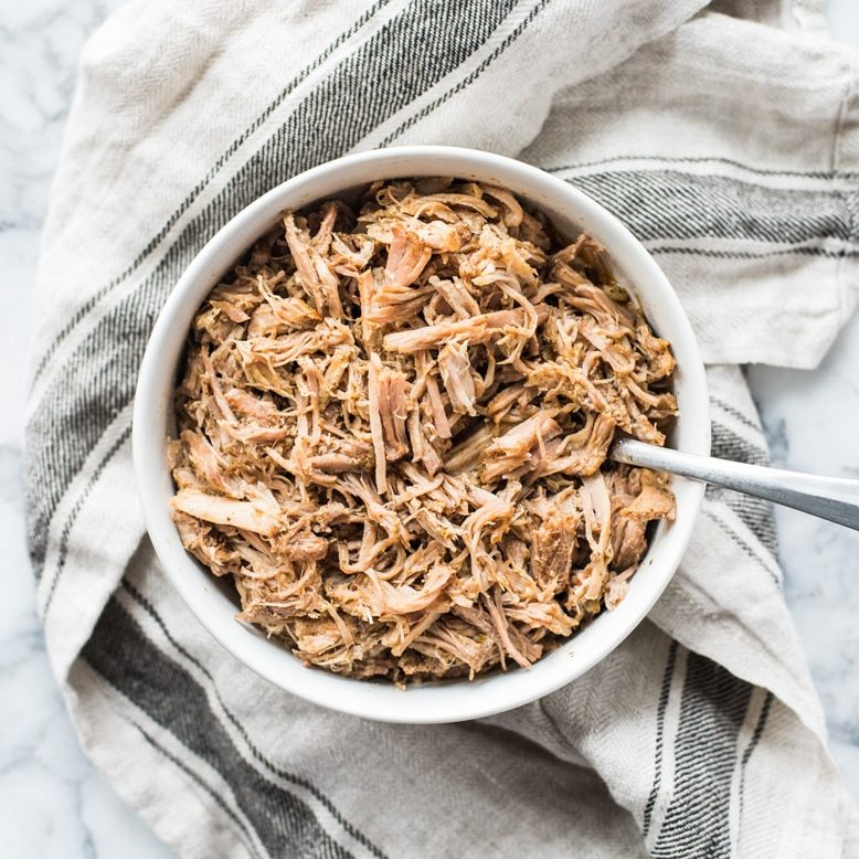This carnitas recipe is made in the slow cooker for a juicy and flavorful Mexican pulled pork perfect for tacos, tostadas, salads and more!