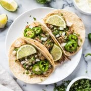 Seasoned with oregano, cumin, chili powder, lime juice, these Mexican Slow Cooker Pork Carnitas Tacos are the perfect meal for any night of the week. (gluten free, dairy free, paleo, healthy, clean eating) // isabeleats.com