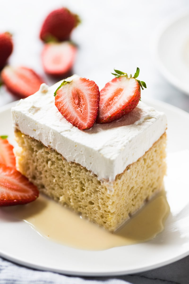 Tres leches cake with three milk mixture on a plate