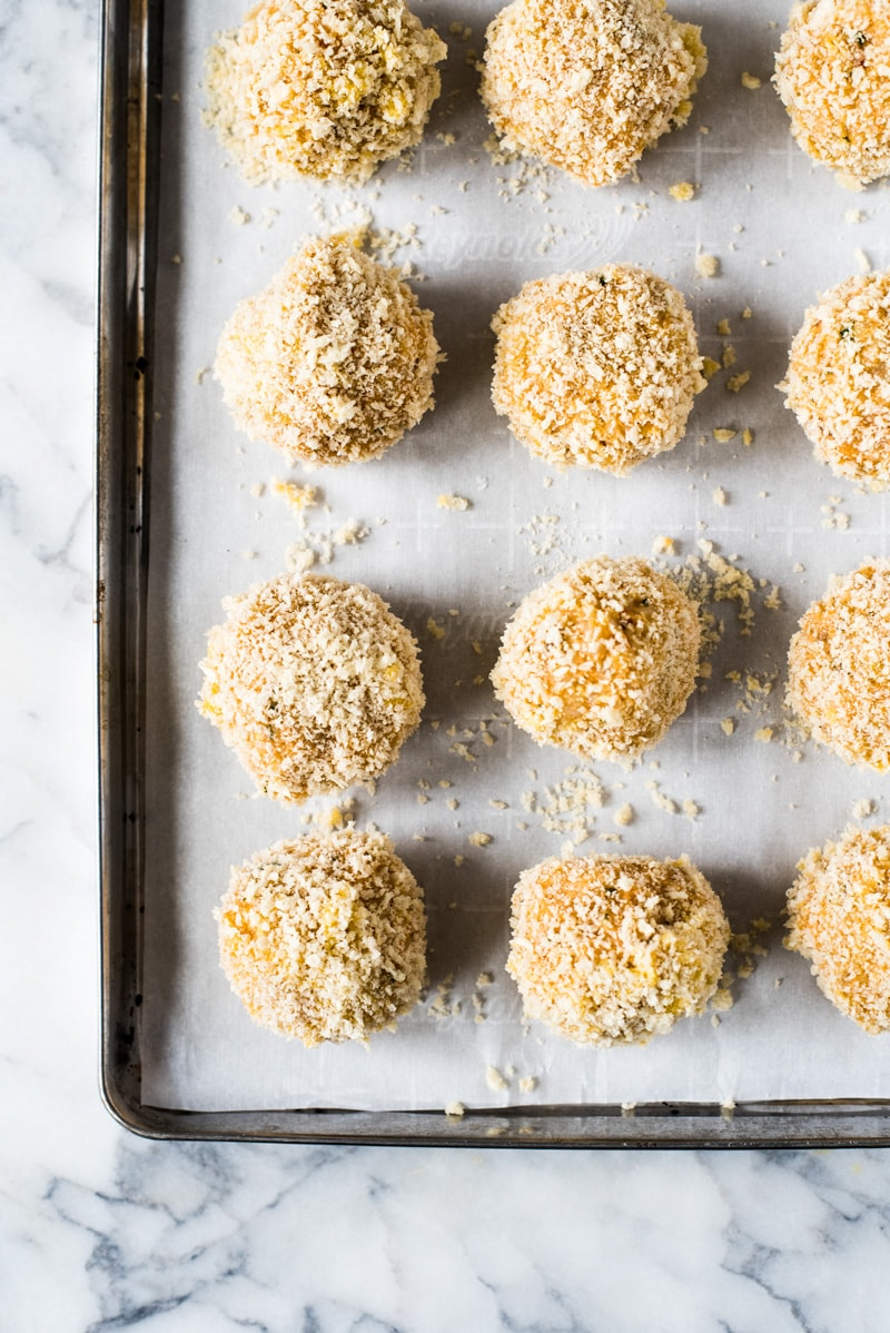 These rice balls rice balls filled with mozzarella cheese and covered in crispy panko breadcrumbs. They're baked, not fried, for a healthier alternative to fried arancini.