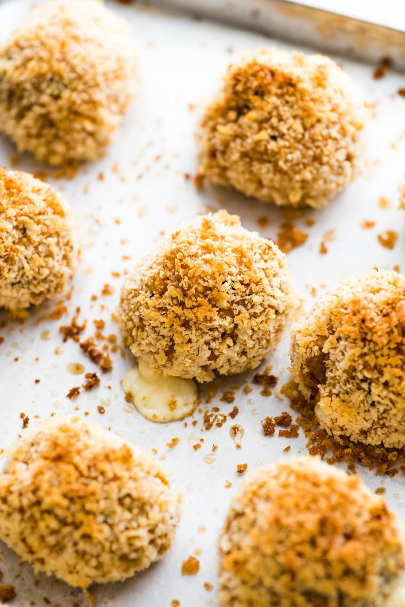 This arancini recipe is baked, not fried, for a healthier alternative to traditional arancini.