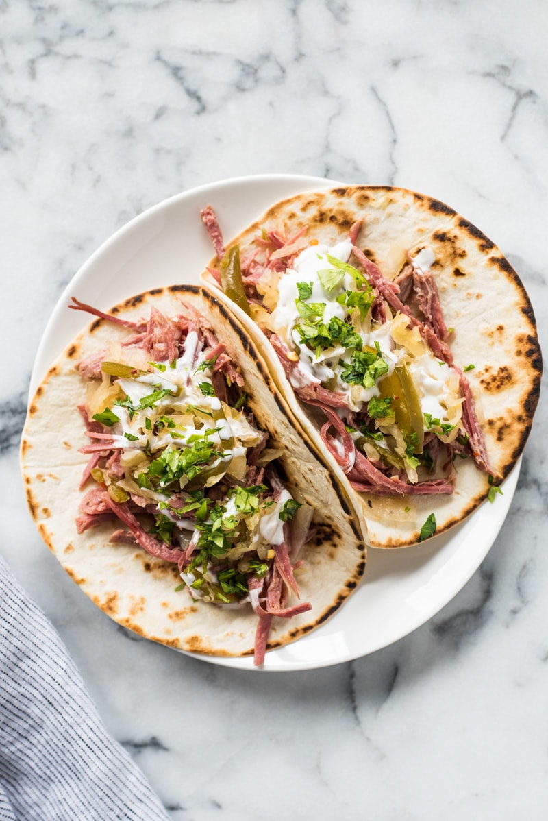 Slow cooker corned beef tacos on a plate
