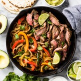 These Easy Steak Fajitas are juicy, tender, flavorful and way better than the ones at your favorite Mexican restaurant! Served with a healthy dose of peppers and onions, these fajitas are gluten free and low carb.