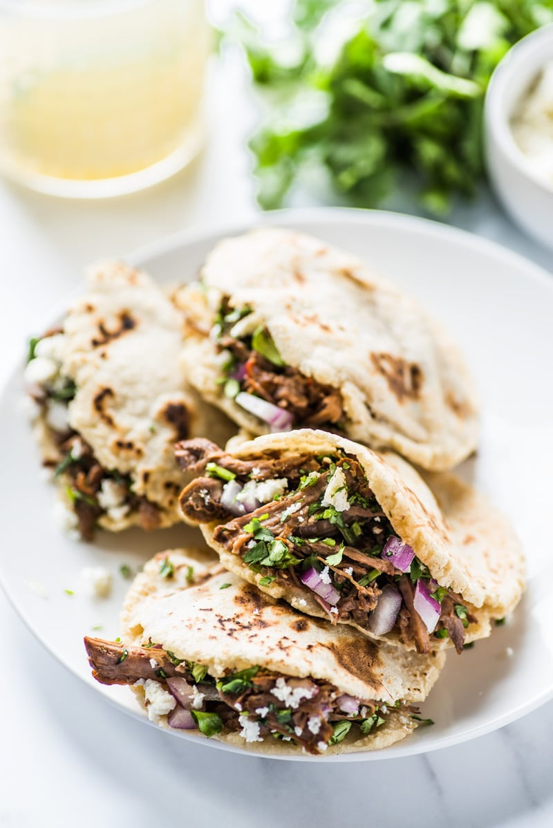 This gorditas recipe is super easy to make! These little corn cakes made from masa dough have a little pocket in the middle made for stuffing with all sorts of delicious fillings! They're also gluten free, vegetarian and vegan.