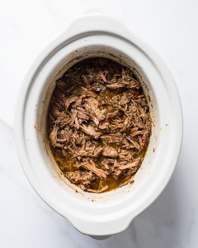 Shredded barbacoa beef in a slow cooker that can be served in tacos, salads, burritos and more!