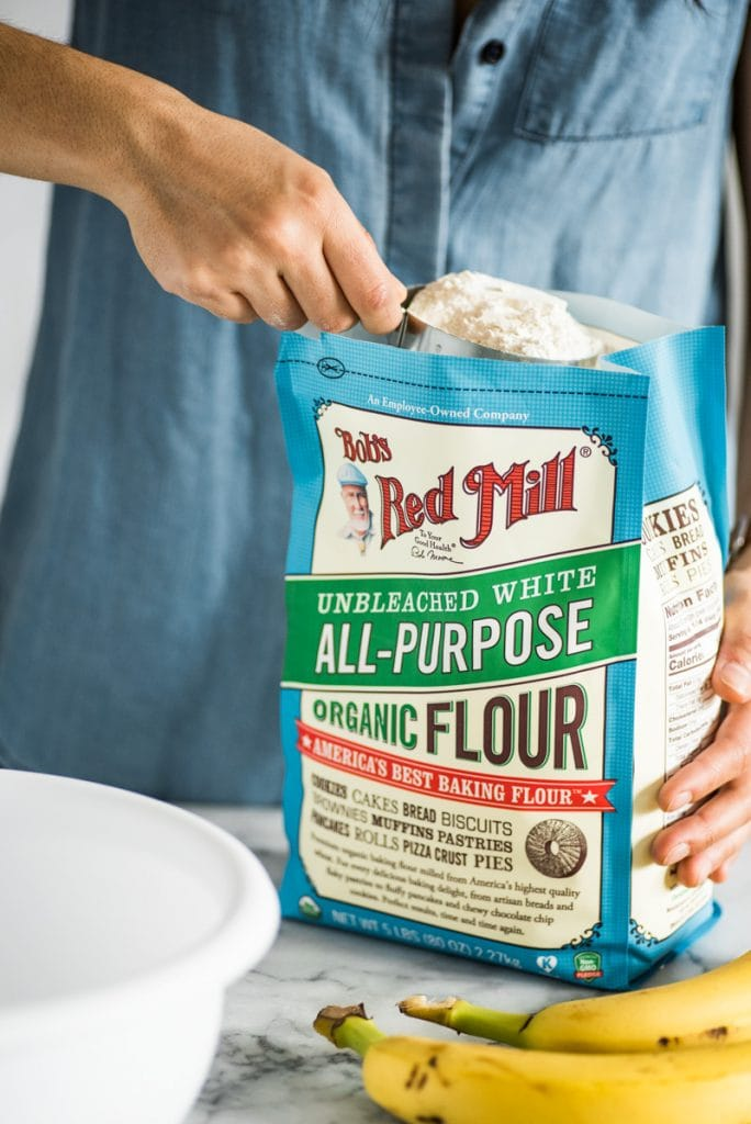 scooping out flour from a bag