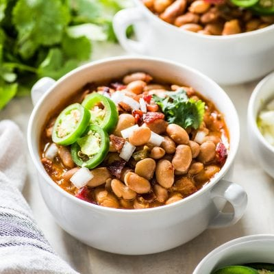 Charro Beans (frijoles charros) in a white bowl.