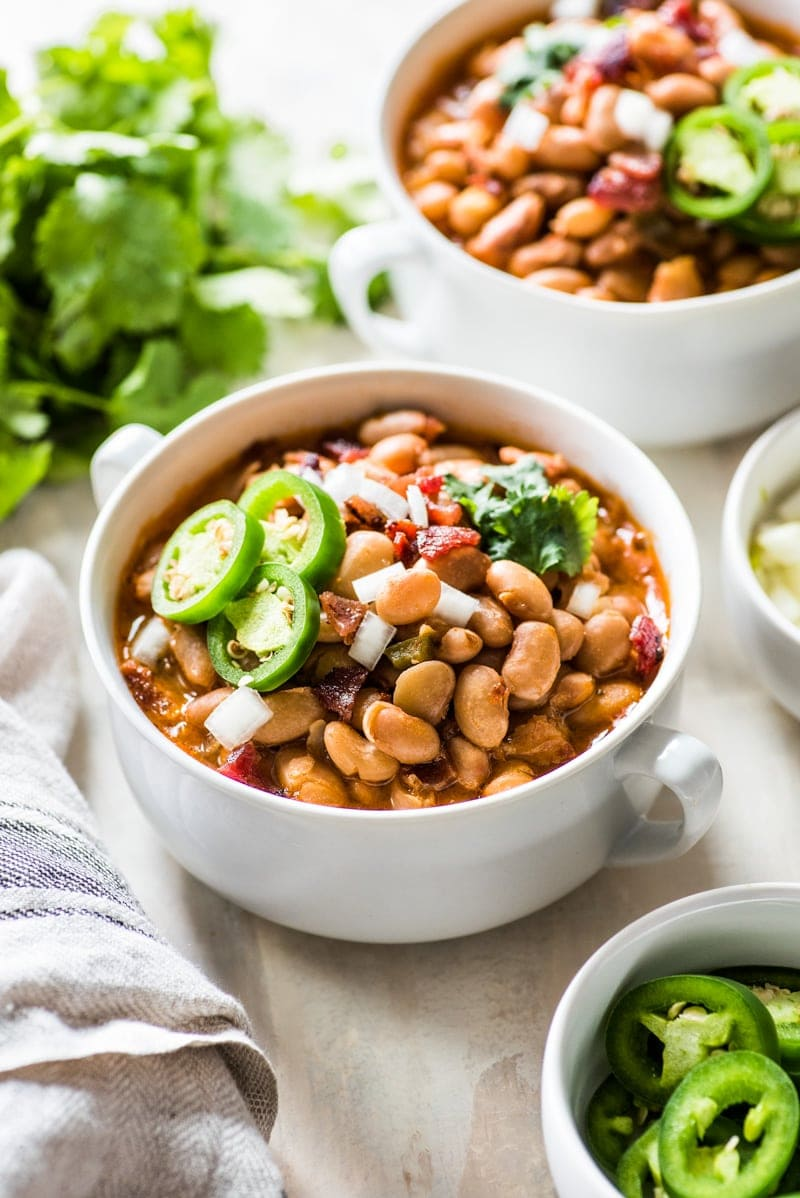 Charro Beans are Mexican-style pinto beanscooked in a broth made from bacon, onions, garlic, chipotle peppers, tomatoes and other delicious spices. Great as a side dish or as a full meal served with some cornbread!