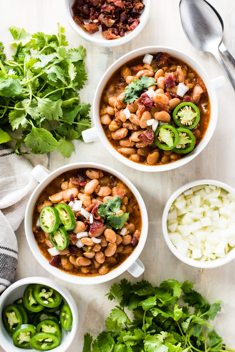 Frijoles Beans are Mexican-style pinto beans cooked in a broth made from bacon, onions, garlic, chipotle peppers, tomatoes and other delicious spices. Great as a side dish or as a full meal served with some cornbread!