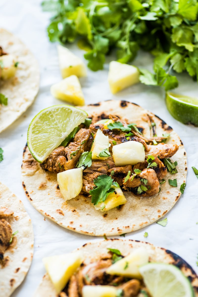 Mexican Tacos Al Pastor made with sweet, tangy and smokey marinated pork grilled to perfection and served with fresh pineapple. The best summer tacos!