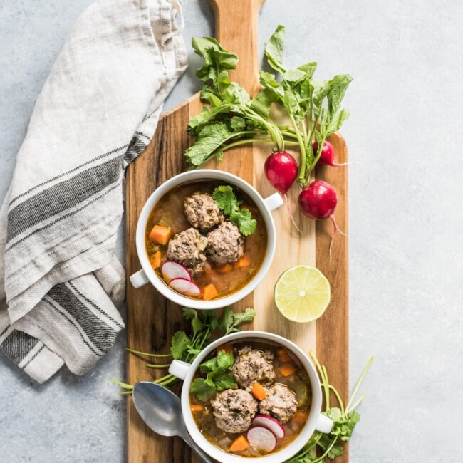 This Albondigas Soup, an authentic Mexican meatball soup, is served in a light and healthy broth full of vegetables and and lean protein! (gluten free, paleo) | isabeleats.com