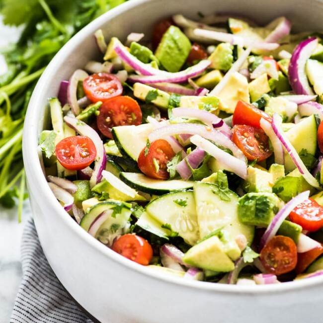 This Avocado Salad recipe is a healthy, fresh and insanely addicting side dish perfect for bbqs, potlucks and get togethers! Ready in only 10 minutes, this recipe is low carb, gluten free, paleo, vegetarian and vegan.