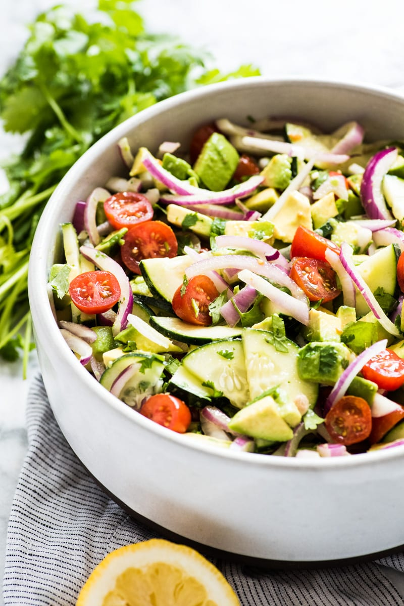 A healthy avocado salad in a large bowl ready to be served.