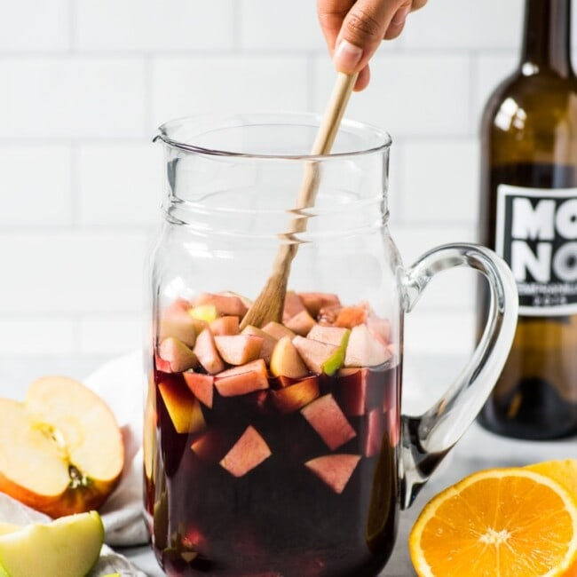 This Sangria Recipe is made with only 6 ingredients including diced apples, oranges and Spanish red wine and is the easiest red sangria ever!
