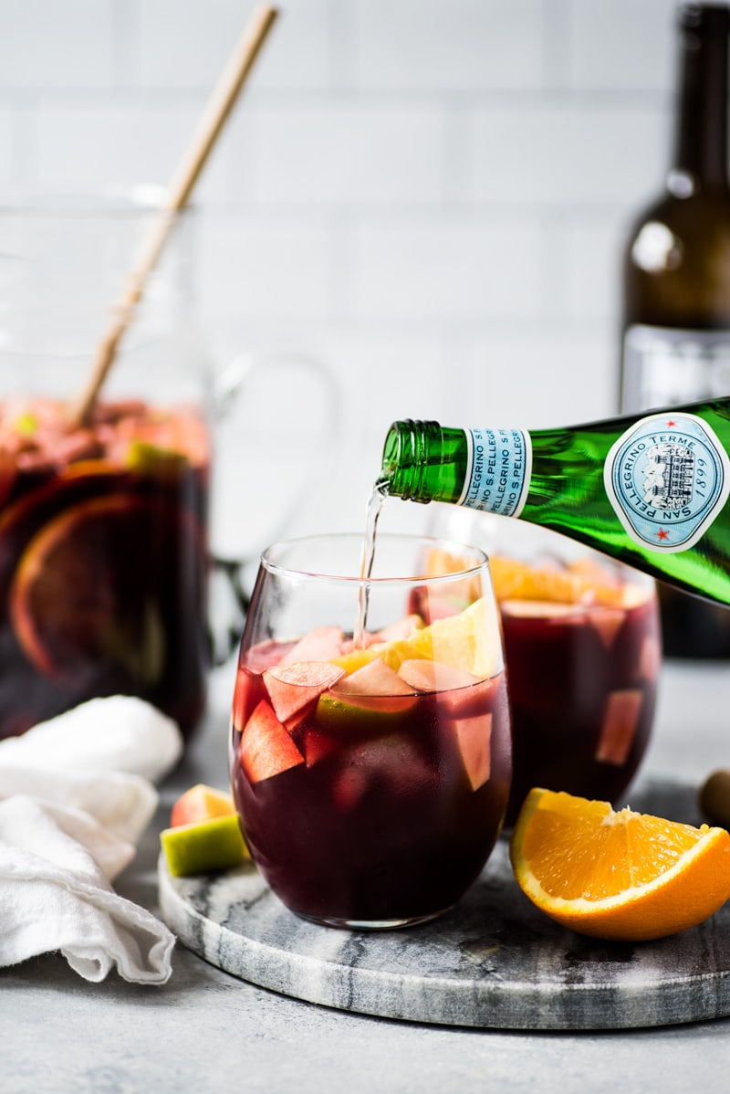 This Red Sangria Recipe is made with only 6 ingredients including diced apples, oranges and Spanish red wine and is the easiest red sangria ever!