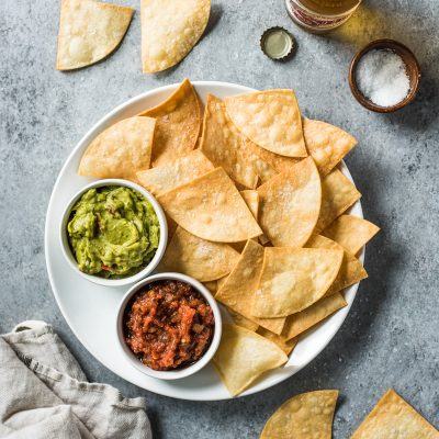 These Homemade Tortilla Chips are the perfect Mexican appetizer. They're crispy, crunchy and won't crumble and fall apart when dipping and snacking!