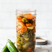 These Pickled Jalapenos are easy to make and are great for topping on all your favorite Mexican foods like nachos, tacos and enchiladas!
