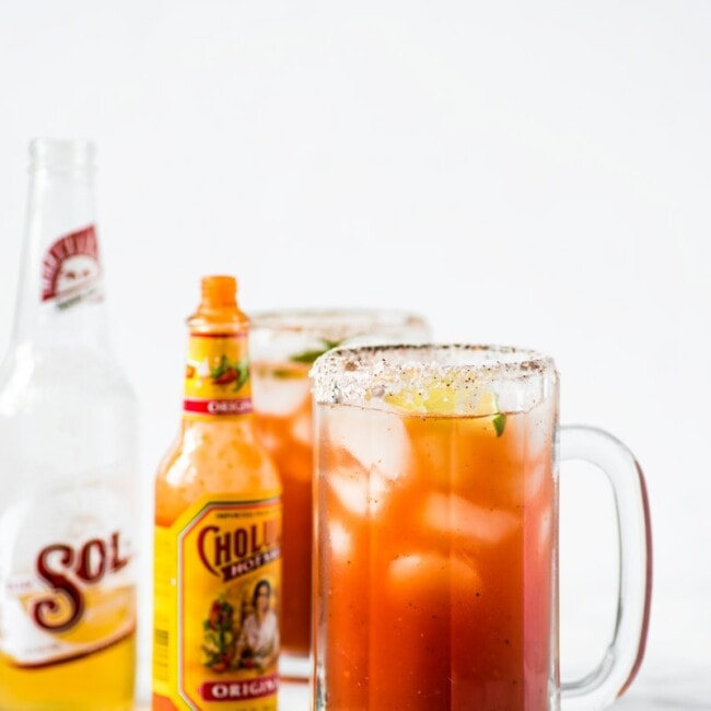 This refreshing Michelada recipe made with Clamato juice and Mexican beer is the perfect cocktail for brunch or alongside your favorite Mexican party foods!