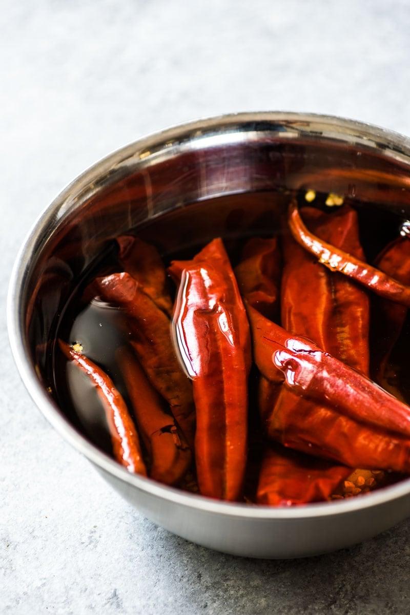Guajillo peppers and chile de arbol peppers soaking for Camarones a la Diabla.