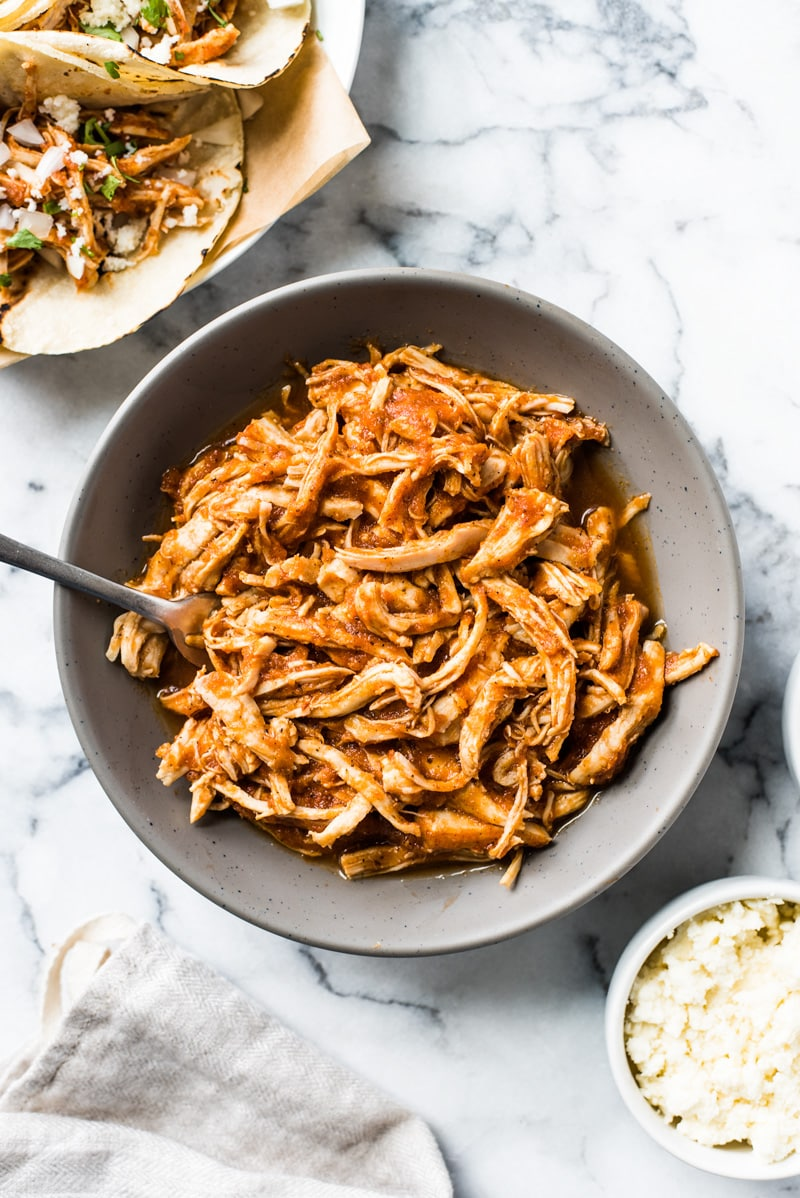 These Easy Chicken Tinga Tacos feature shredded chicken in a smoky chipotle sauce that's ready in only 30 minutes! (gluten free, low carb, paleo)
