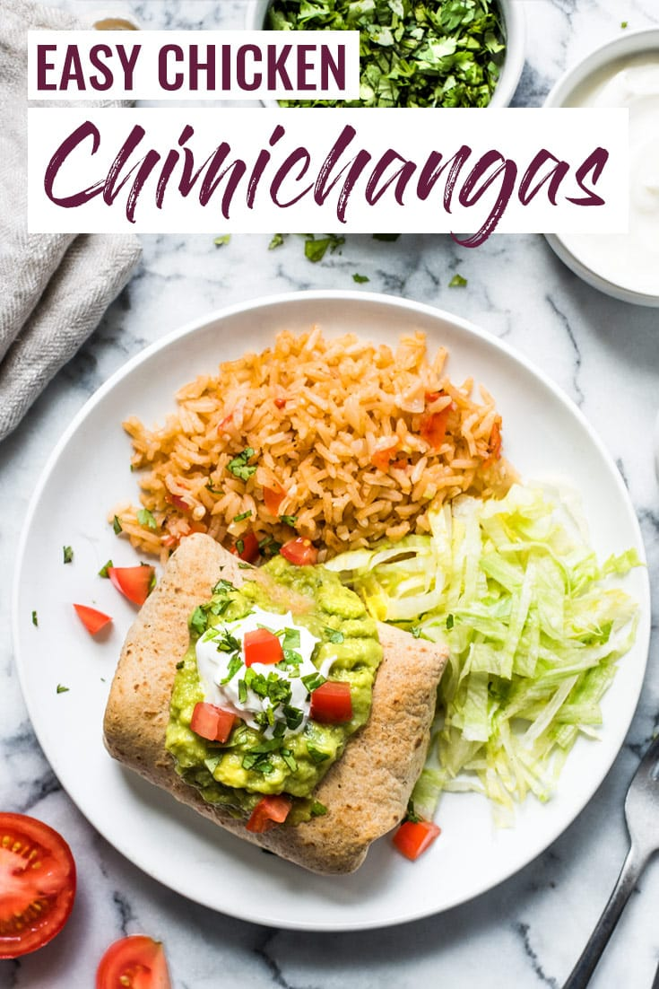 These Easy Chicken Chimichangas are filled with shredded chicken and cheese, rolled in a whole wheat flour tortilla and baked to crispy crunchy perfection. #mexican #burrito #chimichanga #texmex