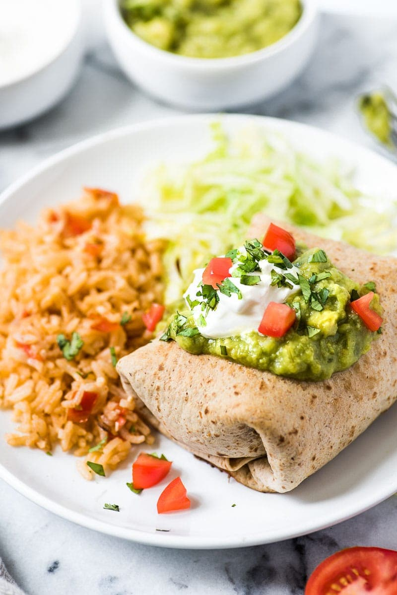 These Easy Chicken Chimichangas are filled with shredded chicken and cheese, rolled in a whole wheat flour tortilla and baked to crispy crunchy perfection.