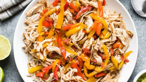 These easy crockpot chicken fajitas are made with only 6 ingredients! Serve in tacos for a weeknight meal or in burrito bowls and salads for a healthy lunch! (gluten free, paleo, low carb)