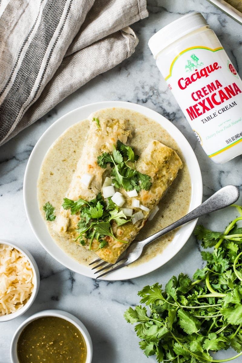 Enchiladas Suizas - enchiladas filled with shredded chicken and cheese and covered with an addicting salsa verde cream sauce. Simply the best!