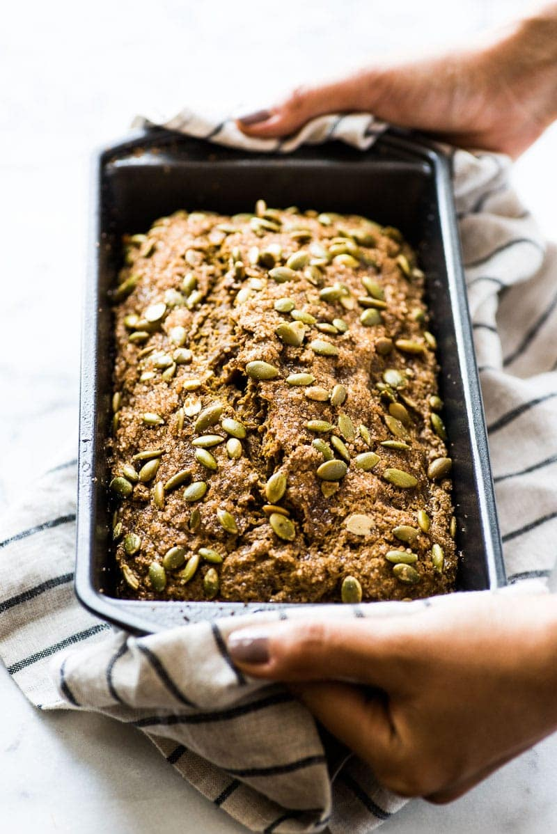 This moist pumpkin bread is easy to make and features a crunchy crust made from turbinado sugar and pepitas! Perfect for the fall and winter seasons!