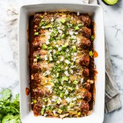 This Red Chicken Enchiladas recipe makes the BEST DINNER EVER! They're stuffed with shredded chicken and cheese, topped with red enchilada sauce and baked for 20 minutes.