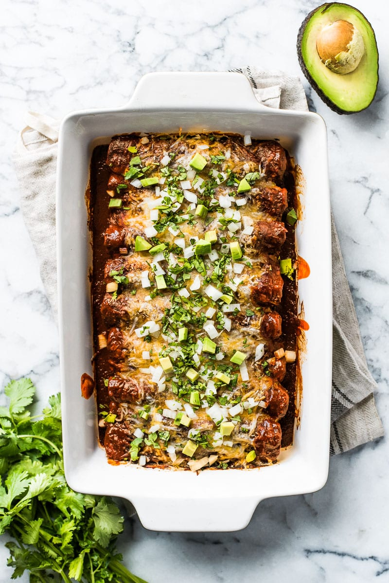 This enchilada recipe makes the Mexican dinner ever! They're stuffed with shredded chicken and cheese, topped with red enchilada sauce and baked for 20 minutes.
