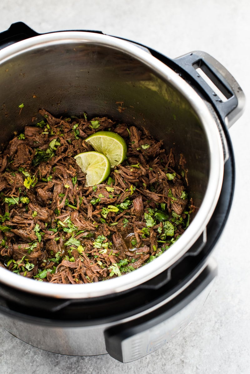 This moist and tender Mexican Shredded Beef is made in the Instant Pot in less than 2 hours! Its delicious by itself or great in tacos, salads and more.