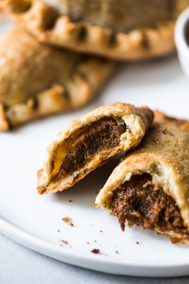 These Easy Pumpkin Empanadas are the perfect handheld fall and winter treat stuffed with a delicious pumpkin filling and wrapped in a sweet pastry dough. They're baked, not fried!