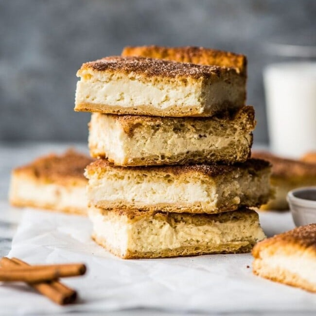 These Sopapilla Cheesecake bars are the perfect combination of light and airy crescent roll dough, creamy cheesecake filling and cinnamon sugar topping!