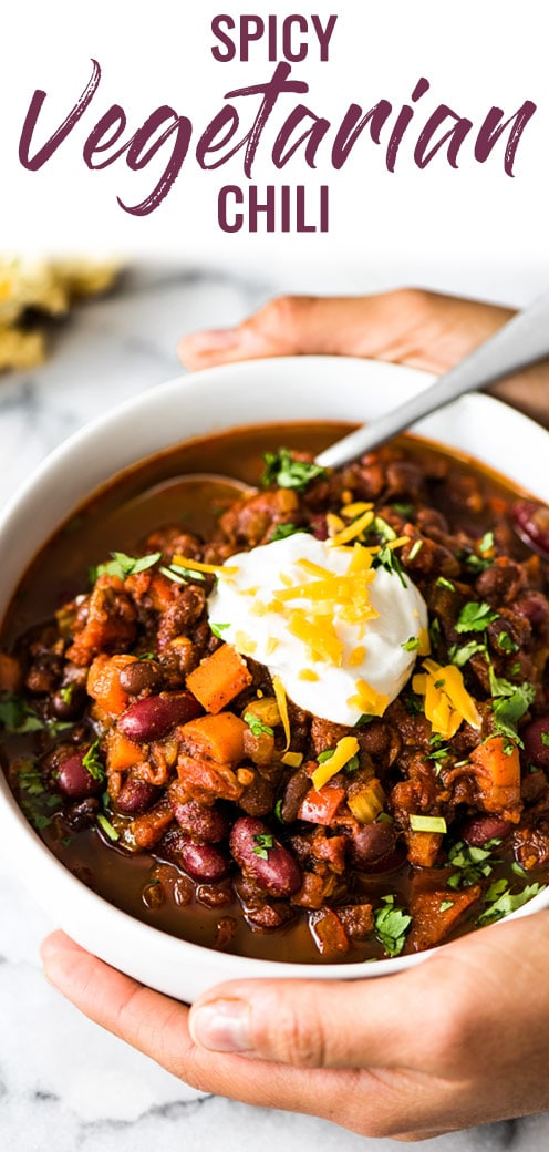 This Spicy Vegetarian Chili is thick, satisfying and super filling! Serve it with your favorite toppings for an easy and healthy meatless meal. (gluten free, vegetarian, vegan) #chili #mexican #serrano