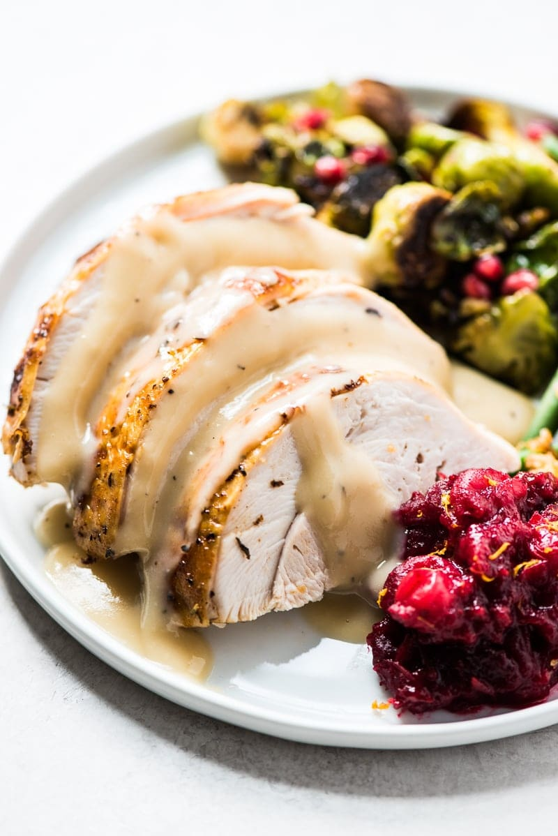 A Thanksgiving dinner plate with a side of cranberry sauce recipe.